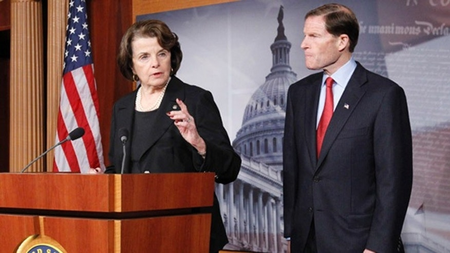 Dec. 21, 2012: Sen. Dianne Feinstein, left, speaks as she and Sen. Richard Blumenthal, right, discuss gun control on Capitol Hill.