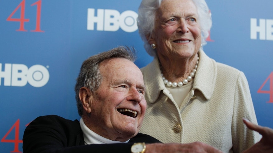 "FILE - In a Tuesday, June 12, 2012 file photo, former President George H.W. Bush, and his wife, former first lady Barbara Bush, arrive for the premiere of HBO's new documentary on his life near the family compound in Kennebunkport, Maine. Bush spokesman Jim McGrath said Wednesday, Dec. 26. 2012 that doctors at the Houston hospital where Bush has been treated for a month remain ""cautiously optimistic"" that he will recover. Still, no discharge date has been set, and McGrath says that doctors are being cautious because at Bush's age ""sometimes issues crop up that are beyond anybody's ability to discern or foretell.""(AP Photo/Charles Krupa, File)"
