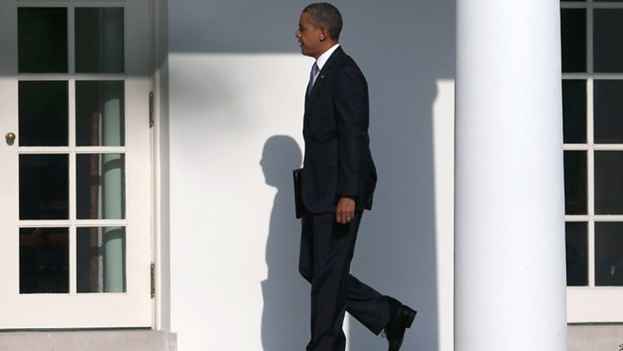 WASHINGTON, DC - AUGUST 21:  U.S. President Barack Obama walks toward the Oval Office before departing on Marine One at the White House, on August 21, 2012 in Washington, DC. President Obama is traveling to Ohio, Nevada and New York to continue campaigning.  (Photo by Mark Wilson/Getty Images)