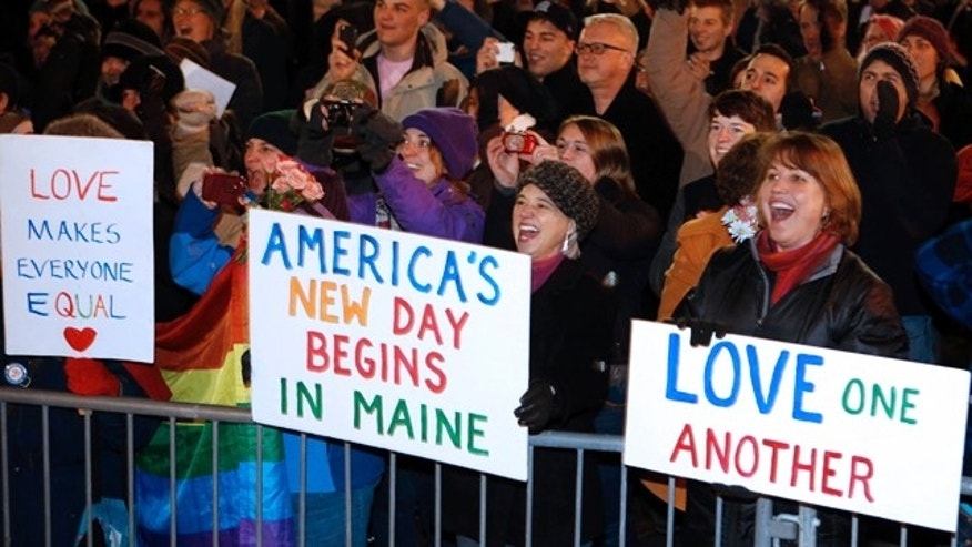 Dec. 29, 2012: A crowd cheers as the first same-sex couple to be legally married in Maine departs City Hall in Portland, Maine.