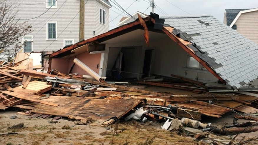 FILE: Oct. 30, 2012: Debris is scattered amidst storm damage from Sandy in Fairfield, Conn.