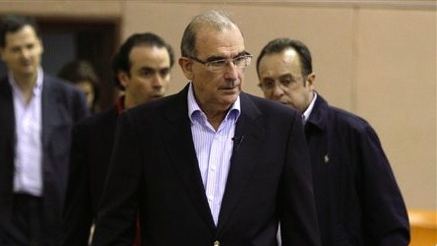 Humberto de la Calle, head of Colombia's government negotiation team, arrives for a press conference on the sidelines of peace talks with the Revolutionary Armed Forces, or FARC, in Havana, Cuba, Friday, Dec. 21, 2012.