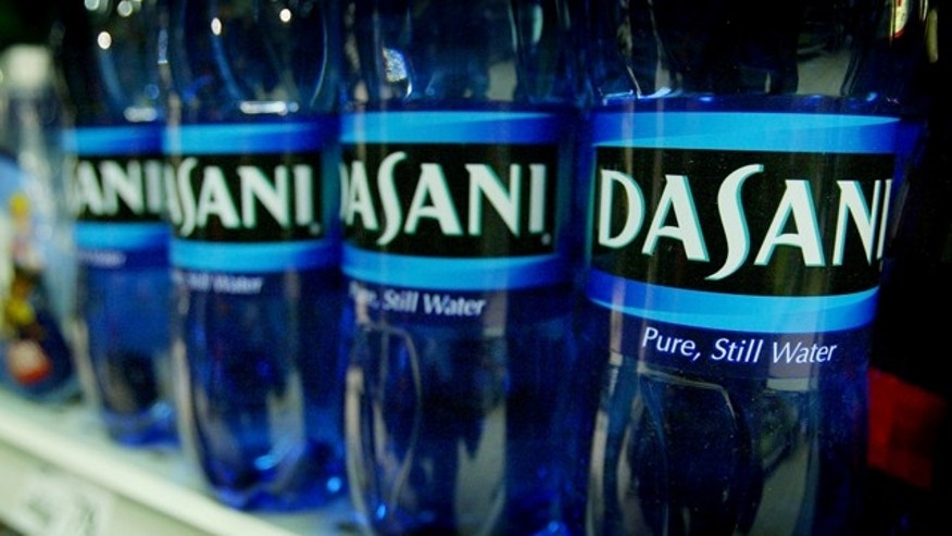Bottles of Dasani water are seen on sale at a central London supermarket, March 19, 2004. The Coca-Cola company said on Friday it had recalled its entire Dasani range of bottled water from the British market after levels of bromate were found to exceed UK legal standards. REUTERS/Peter Macdiarmid  PKM/ASA/ACM