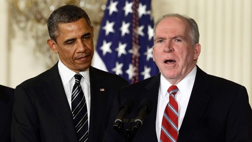 Jan. 7, 2013: President Obama listens as his nominee for CIA director, John Brennan, speaks at the White House.