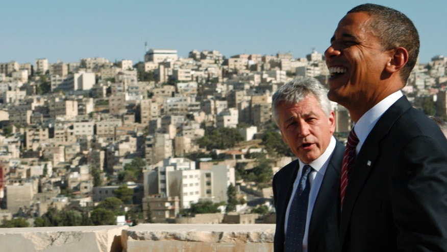 FILE: July 22, 2008: Then-Sen. Chuck Hagel with then-presidential candidate and Sen. Barack Obama at the Amman Citadel in Amman, Jordan.
