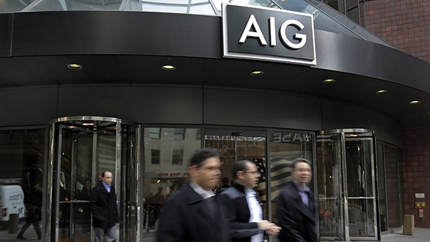 Jan. 8, 2013: People pass the AIG building in New York. American International Group Inc. said Tuesday its board of directors will weigh whether to take part in a shareholder lawsuit against the U.S. over the government's $182 billion bailout of the insurer. (AP)