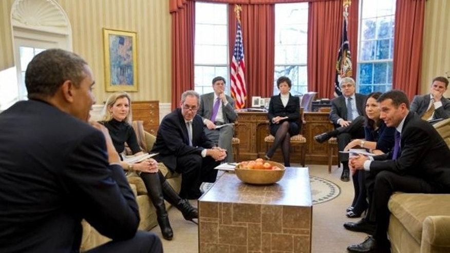This photo shows President Obama meeting Jan. 8, 2013 with senior advisers in the Oval Office. Unlike a previously released photo, this one shows several female advisers.
