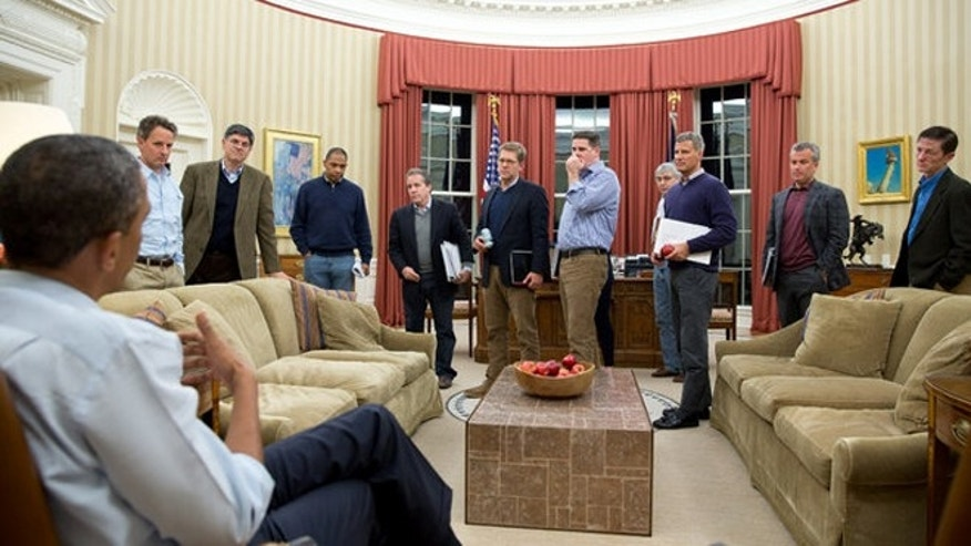 This Dec. 29, 2012 photo shows President Obama meeting with senior advisers in the Oval Office. Only men are visible, though adviser Valerie Jarrett was in the room.