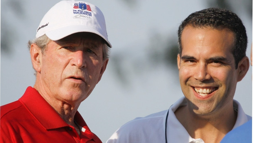 FILE: Sept. 24, 2012: George P. Bush, right, stands with his uncle, former President George W. Bush, during a charity golf tournament in Irving, Texas.