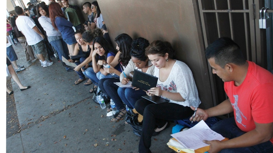 FILE: August 15, 2012: People wait for help with paperwork for the Deferred Action for Childhood Arrivals program at the Coalition for Humane Immigrant Rights of Los Angeles, in Calif.