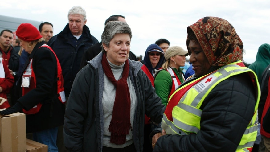 FILE: November 2, 2012: U.S. Homeland Security Secretary Janet Napolitano greets a American Red Cross volunteer while touring  storm-damaged Staten Island, N.Y.