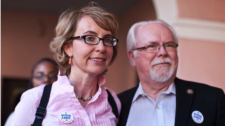 FILE: Nov. 5, 2012: Former Rep. Gabrielle Giffords with now Rep. Ron Barber, R-Ariz., after casting ballots in downtown Tucson, Ariz.