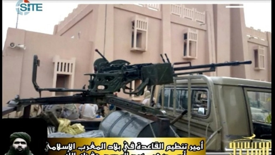 This photo, obtained by the SITE Intelligence Group, purports to show terrorists in possession of Libyan weapons.