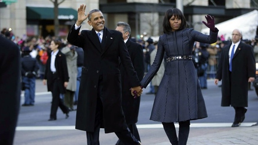 Jan. 21, 2013: President Obama and first lady Michelle Obama walk down Pennsylvania Avenue during the 57th Presidential Inauguration parade in Washington.