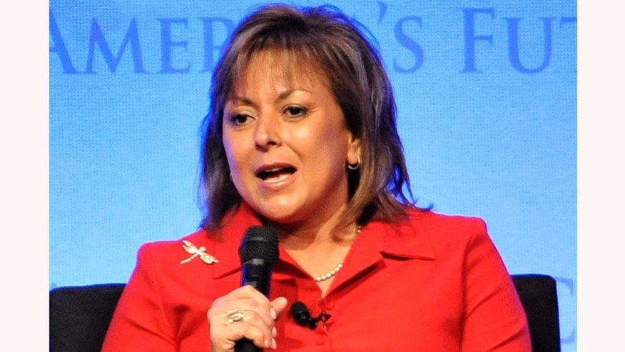 FILE - In this Nov. 17, 2010 file photo,  New Mexico Gov. Susana Martinez speaks during the plenary session at the Republican Governors Association meeting in San Diego.  A House committee is expected to vote on a proposal by Martinez to stop promoting third-graders who can't read. It's a key piece of the new governor plan for reform public schools. (AP Photo/Denis Poroy, File)