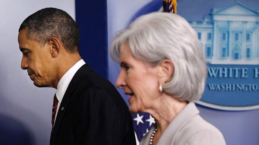 Feb. 10, 2012: In this file photo, President Barack Obama and Health and Human Services Secretary Kathleen Sebelius leave the Brady Press Briefing Room of the White House in Washington, after the president announced the revamp of his contraception policy requiring religious institutions to fully pay for birth control.