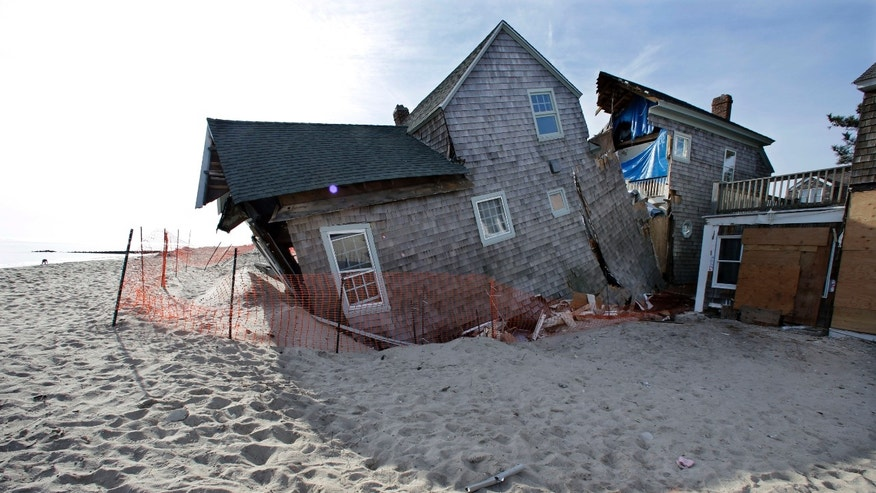 Jan. 3, 2013: File photo; a beach front home that was severely damaged by Superstorm Sandy rests in the sand in Bay Head, N.J.