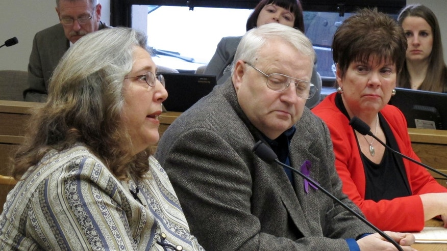 Feb. 1, 2013: Judy Cox, mother of missing Utah mother Susan Powell, testifies before a Senate committee as her husband, Chuck, center, and Sen. Pam Roach, right, listen in Olympia, Wash.