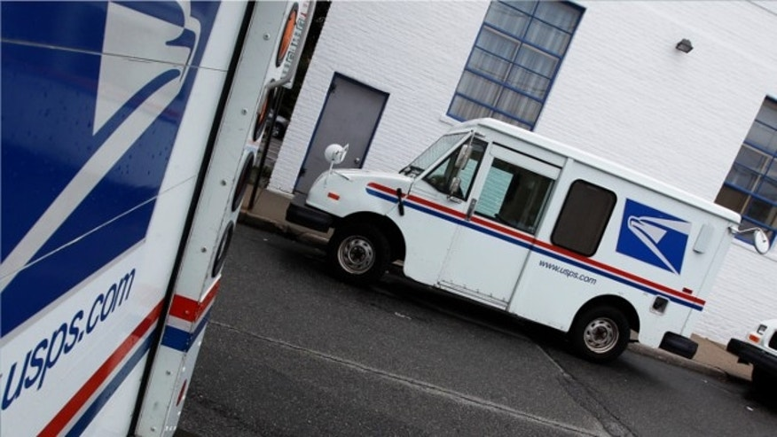 August 1, 2012: U.S. Postal Service trucks are seen in Manhasset, New York.