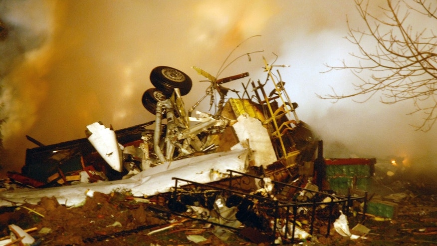 Feb. 12, 2009: In this file photo, the wreckage of Continental flight 3407 lies amid smoke at the scene after crashing into a suburban Buffalo home and erupting into flames, killing all 48 people aboard and at least one person on the ground, according to authorities.