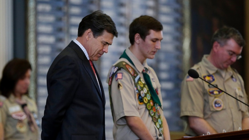 Feb. 2, 2013: Gov. Rick Perry, left, bows his head for the invocation during the annual Boy Scouts Parade and Report to State in the House Chambers at the Texas State Capitol, in Austin, Texas.