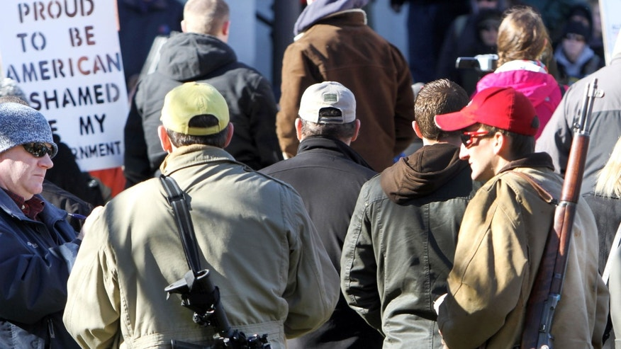 Jan. 31, 2013: In this file photo, gun owners rally to promote the right to bear arms in front of the Statehouse in Concord, N.H.