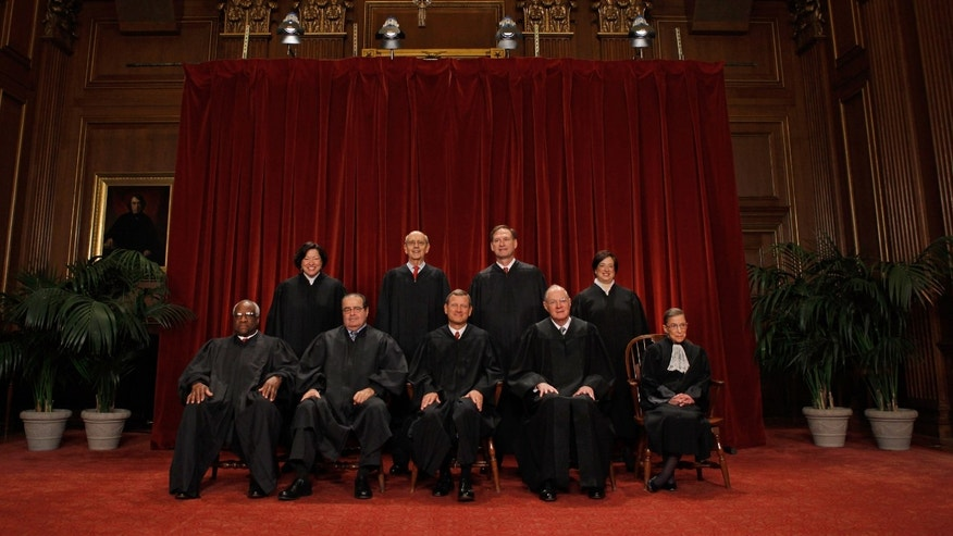 U.S. Supreme Court members   Clarence Thomas, Antonin Scalia, Chief Justice John Roberts,  Anthony Kennedy,  Ruth Bader Ginsburg, (back row L-R)  Sonia Sotomayor,  Stephen Breyer, Samuel Alito and  Elena  Kagan