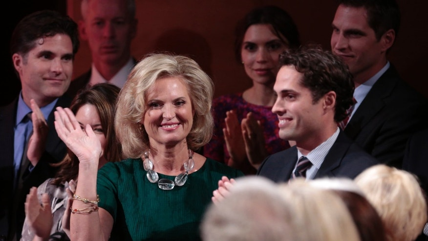 FILE: October 22, 2012: Republican presidential nominee Mitt Romney's wife. Ann, with sons Tagg (L) and Craig (R) at a debate in Boca Raton, Florida.