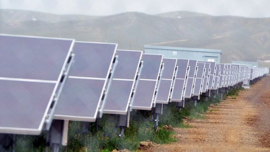 In this Aug. 3, 2011 file photo, solar panels are seen at a solar farm in Avenal, Calif.