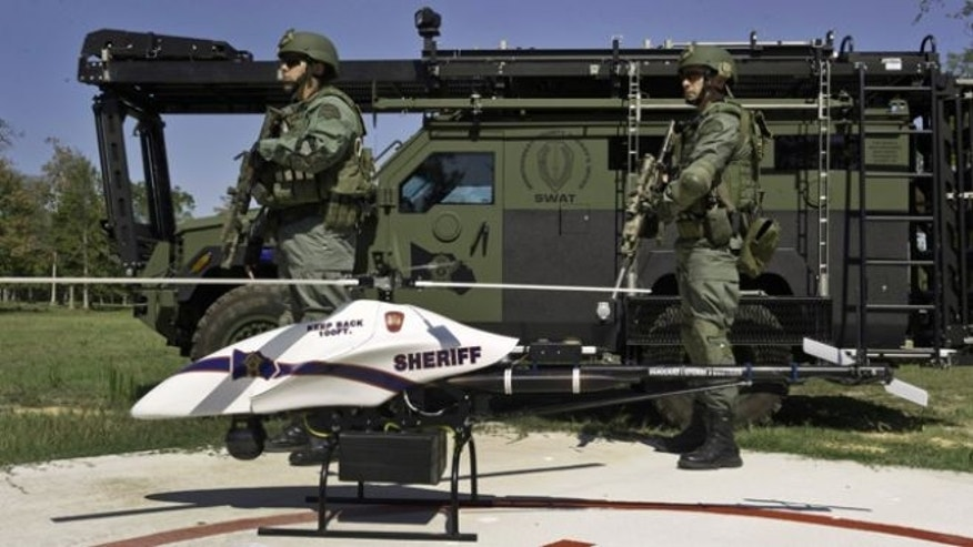 Sept. 2011: This photo provided by Vanguard Defense Industries, shows a ShadowHawk drone with Montgomery County, Texas, SWAT team members.