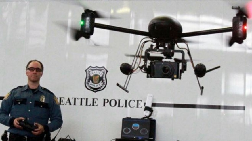 April 27, 2012: Seattle Police officer Reuben Omelanchuk is at the controls of the department's new, small radio-controlled Draganflyer X6 drone with a camera attached, in Seattle.