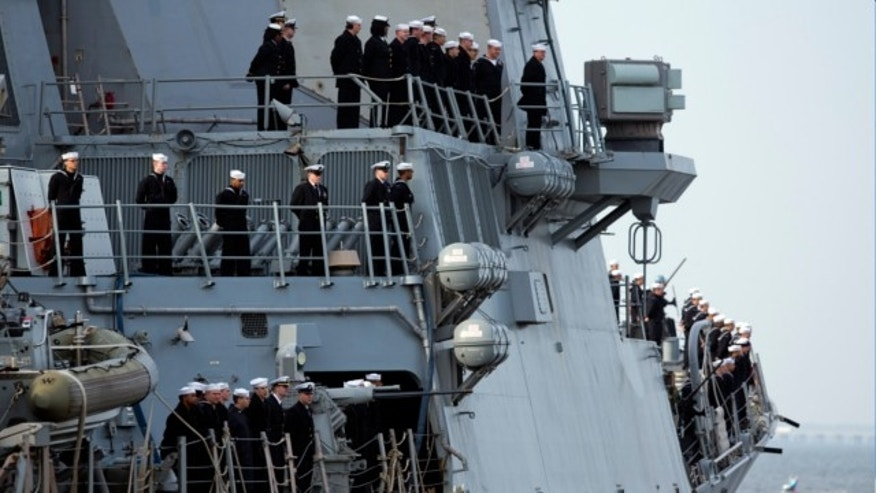 Feb. 7, 2013: Sailors man the rails aboard the guided -missile destroyer USS Barry as the ship depart the Norfolk Naval Station for a 6-month deployment.