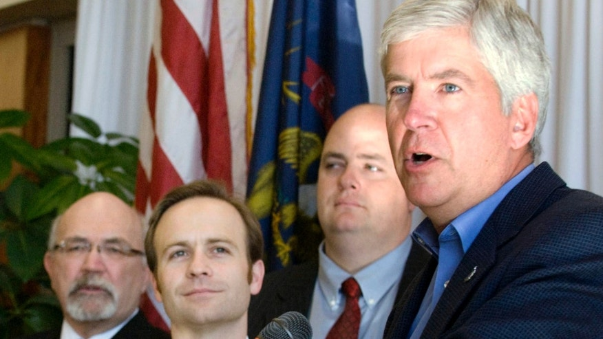 FILE: Feb. 6, 2013: Michigan GOP Gov. Rick Snyder announces an expansion of the state's Medicaid health care program in Lansing, Mich.