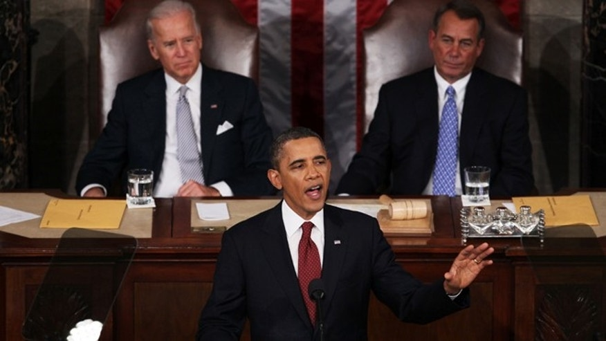 "WASHINGTON, DC - JANUARY 24:  U.S. President Barack Obama, flanked by Vice President Joe Biden (L) and Speaker of the House John Boehner (R-OH)delivers his State of the Union address on January 24, 2012 in Washington, DC. Obama said the focal point his speech is the central mission of our country, and his central focus as president, including ""rebuilding an economy where hard work pays off and responsibility is rewarded.""  (Photo by Mark Wilson/Getty Images)"