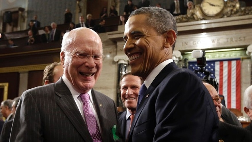 Sen. Patrick Leahy, D-Vt. greets President Barack Obama after the president gave his State of the Union address during a joint session of Congress on Capitol Hill in Washington, Tuesday Feb. 12, 2013. (AP Photo/Charles Dharapak, Pool)