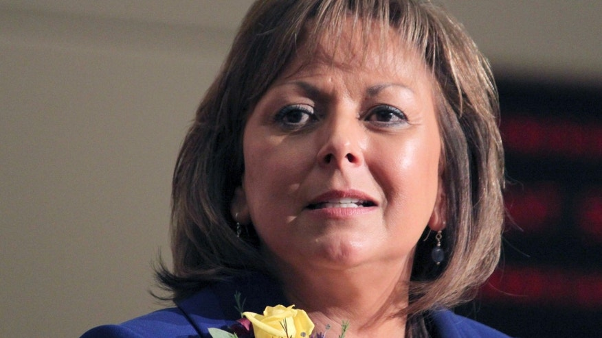 FILE - In this Jan. 17, 2012, photo, New Mexico Gov. Susana Martinez speaks in Santa Fe, N.M.  The Republican National Committee has announced that Martinez will be one of the speakers at the 2012 GOP Convention in Tampa. (AP Photo/Susan Montoya Bryan, File)