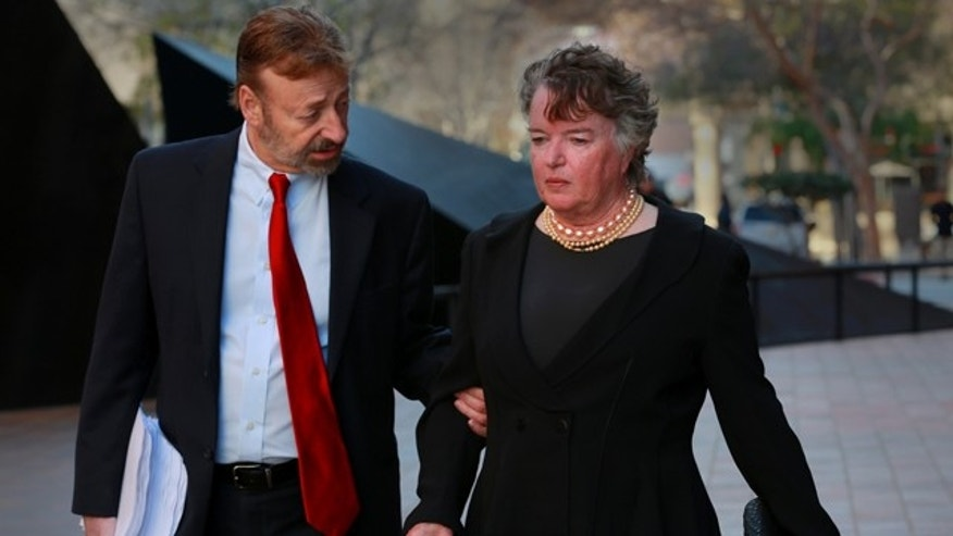 Feb. 14, 2013: Former San Diego mayor Maureen O'Connor, right, walks to federal court in San Diego.