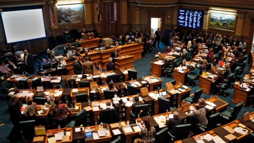 Feb. 15, 2013: House members gather in their Chamber at the Capitol in Denver.