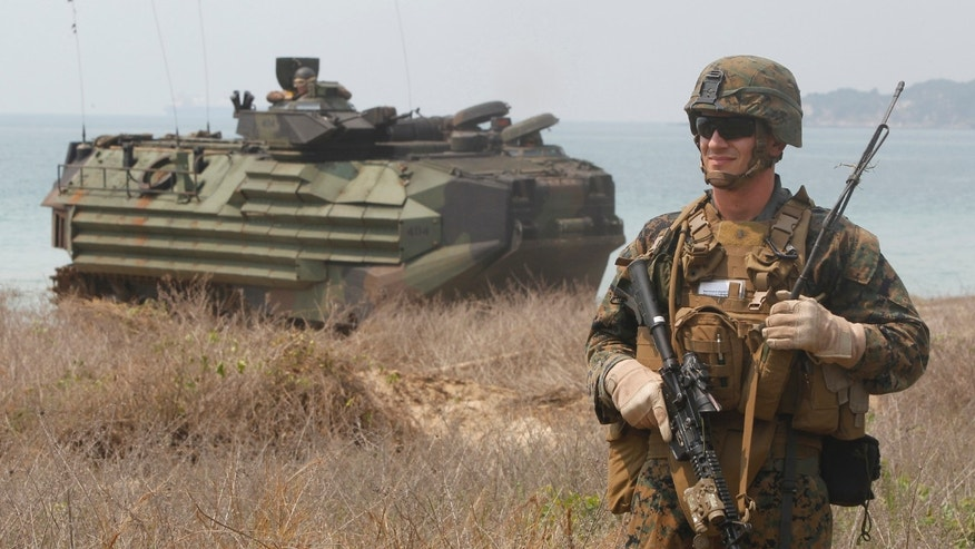 FILE: February 14, 2013: A U.S. Marine participates in an amphibious assault exercise as part of the Cobra Gold 2013's joint military exercise at a military base in Chonburi province, east of Bangkok, Thailand.
