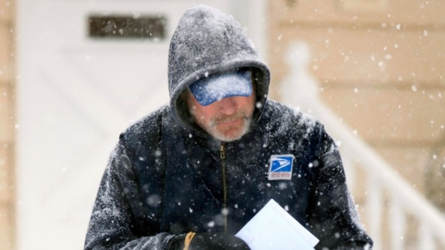Dec. 19, 2009: U. S. Post Office letter carrier Tim Bell delivers the mail during a snow storm in Havertown, Pa.