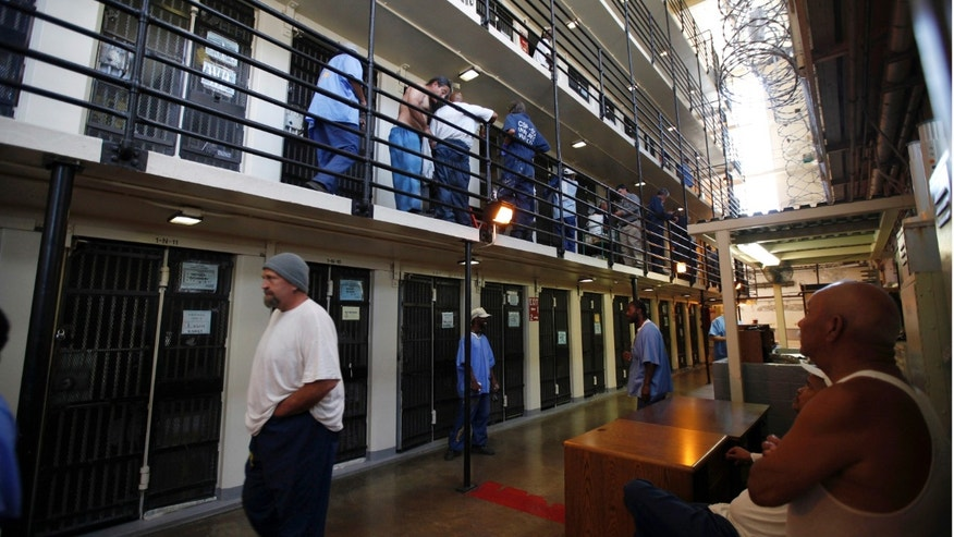 June 8, 2012: Inmates walk outside their cells at San Quentin state prison in San Quentin, Calif.