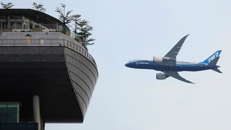 February 14, 2012: A Boeing 787-8 passenger jet flies in Singapore.