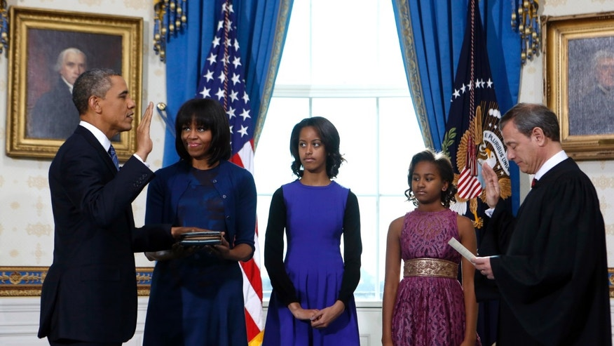 Sunday, Jan. 20, 2013: President Obama is officially sworn-in by Chief Justice John Roberts in the  White House in Washington. He is with first lady Michelle and daughters Malia and Sasha.