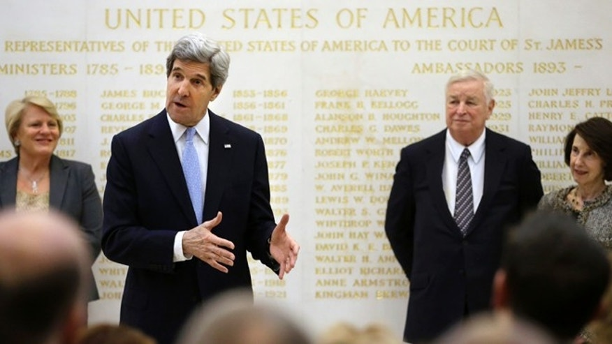 Feb. 25, 2013: U.S. Secretary of State John Kerry, second from left, speaks alongside U.S. Ambassador Louis Susman, third from left, during a visit to the U.S. Embassy, London.