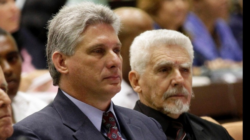 Vice President of the Council of Ministers Miguel Diaz-Canel, center, Commander of the Cuban Revolution Ramiro Valdes, right, and Ricardo Alarcon, outgoing parliamentary president, attend the opening session of the National Assembly in Havana, Cuba, Sunday, Feb. 24, 2012.