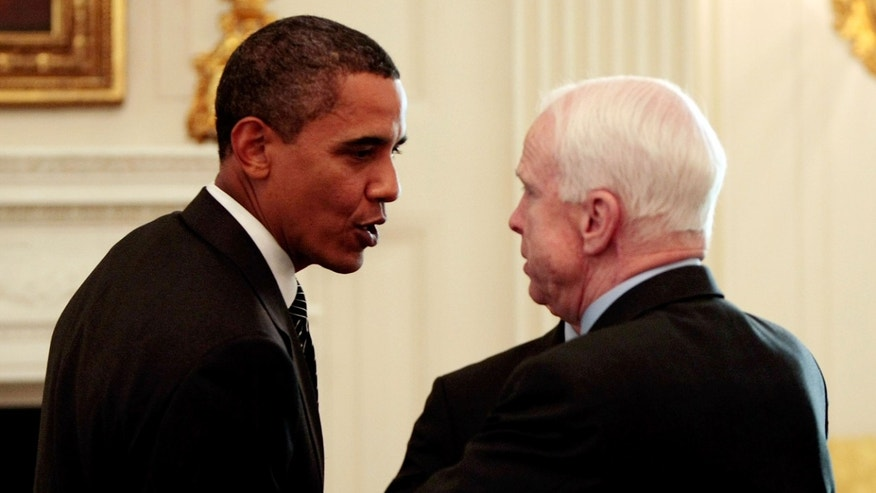 U.S. President Barack Obama (L) talks with Sen. John McCain (R-AZ) after a meeting with a bipartisan group of Senators and members of Congress in 2009.