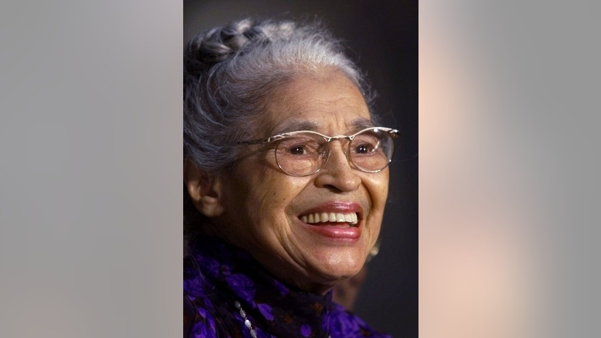 FILE -- In a June 15, 1999 file photo Rosa Parks smiles during a Capitol Hill ceremony where  Parks was honored with the Congressional Gold Medal in Washington.   Parks will become the first black woman to be honored with a full-length statue in the Capitols Statuary Hall on Wednesday Feb. 27, 2013.   (AP Photo/Khue Bui)