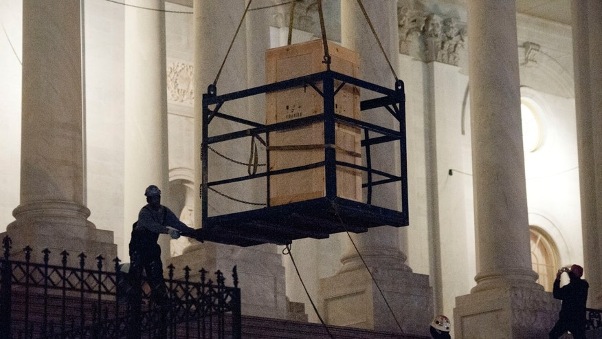 A bronze statue of Rosa Parks is delivered to the U.S. Capitol&#39&#x3b;s Memorial Door by a crane, in Washington, Friday, Feb. 22, 2013, where it will join the U.S. Capitol Art Collection. Authorized by Public Law 109-116, as modified by Public Law 110-120, the Rosa Parks statue represents the first commission of a full-sized statue approved and funded by the U.S. Congress since 1873. It will be installed in National Statuary Hall in the United States Capitol on February 27, 2013.  (AP Photo/Cliff Owen)