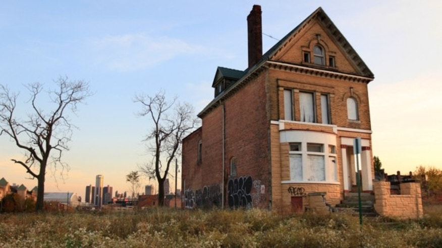 Oct. 24, 2012: This photo shows a graffiti-marked abandoned home north of downtown Detroit.