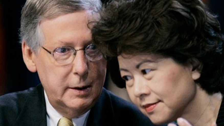 Aug. 13, 2007: Senate Republican leader Mitch McConnell talks with his wife, U.S. Secretary of Labor Elaine L. Chao during the Fraternal Order of Police convention in Louisville, Ky.